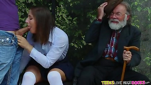 Schoolgirl entertains with a cock near her grandpa