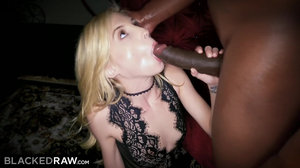 Petite blonde gags on a big black cock